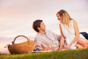 Couple Enjoying Romantic Sunset Picnic